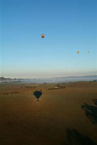 Hot Air Balloon Silhoutted by the Rising Sun